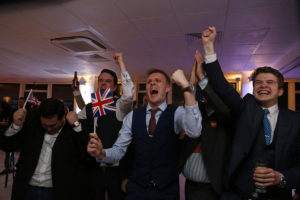 Leave.EU supporters wave Union flags and cheer as the results come in at the Leave.EU referendum party at Millbank Tower in central London early in the morning of June 24, 2016. First results from Britain's knife-edge referendum showed unexpectedly strong support for leaving the European Union on Friday, sending the pound plummeting as investors feared a historic blow against the 28-nation alliance. / AFP PHOTO / GEOFF CADDICKGEOFF CADDICK/AFP/Getty Images